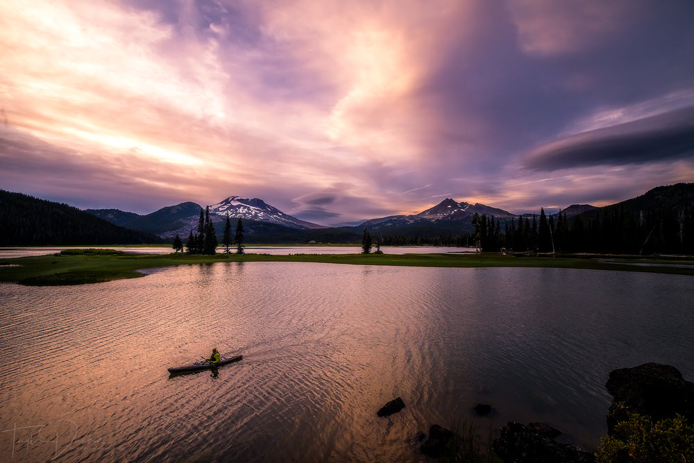 A kayaker paddles across Sparks Lake under a dramatic sky - he was the first of about 10 paddlers I saw!