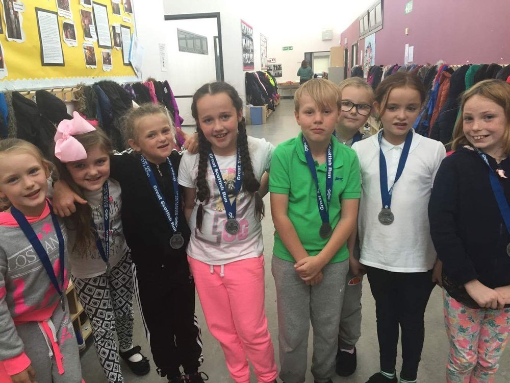 P5 Race for Life Medals.JPG