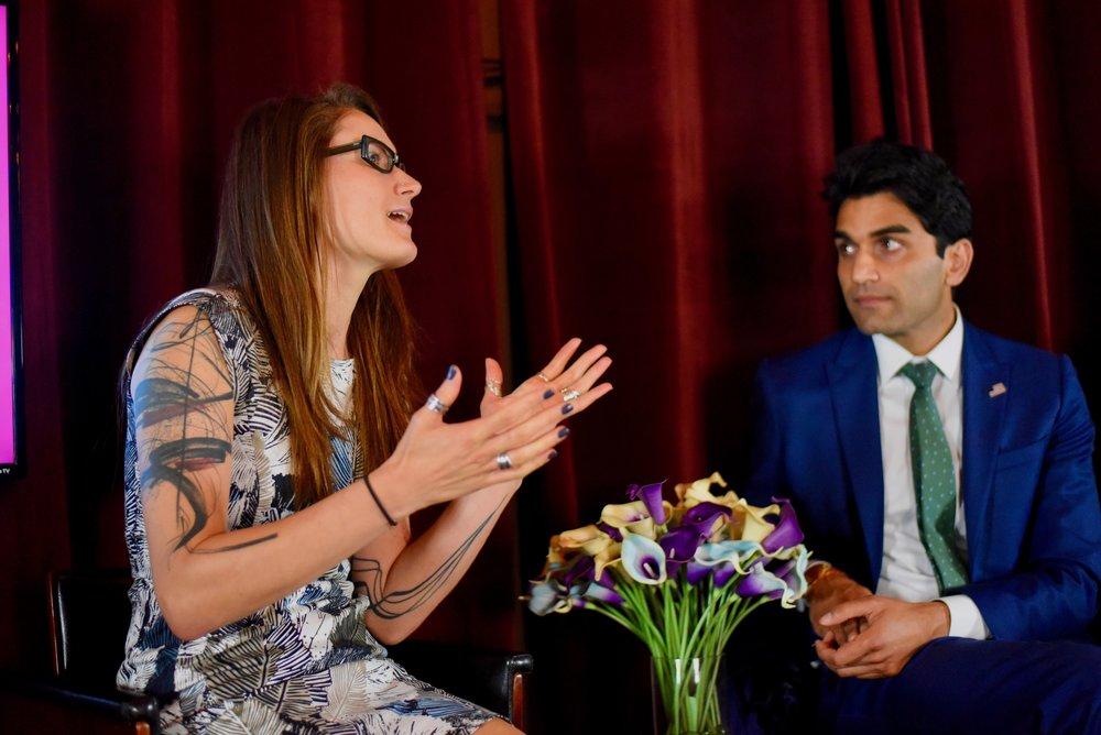 Dr. Zhana (left) talking to Suraj Patel.
