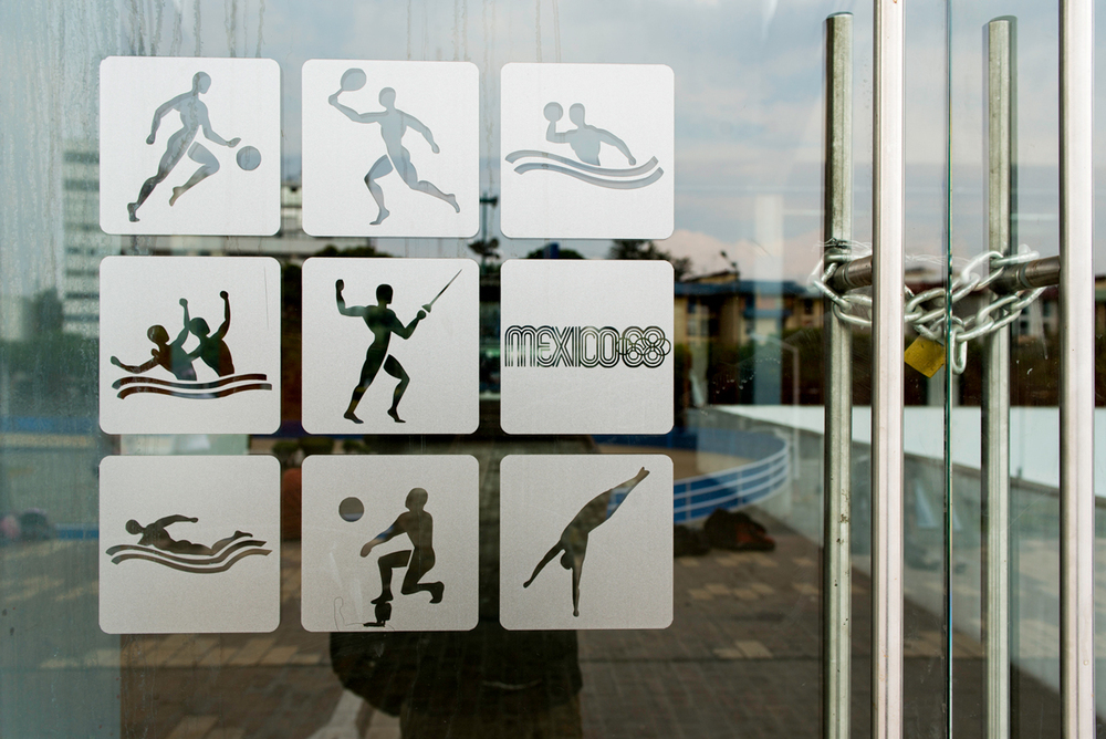 '68 Olympic logo on door at Francisco Márquez Olympic Pool, Mexico City.