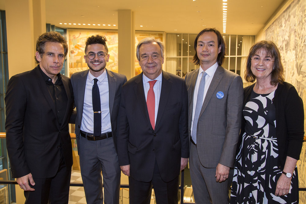 "For World Refugee Day 2017, Ahmed read his poem,  ""A Thank You Letter From the Bomb that visited My Home""  at a private United Nations reception. From left to right: Ben Stiller, Ahmed, UN Secretary General Antonio Guterres, Christopher Tin, and UNHCR NY Director Ninette Kelly. (Scott Nelson)"