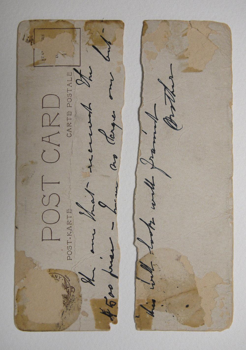 Verso of postcard showing handwritten message.