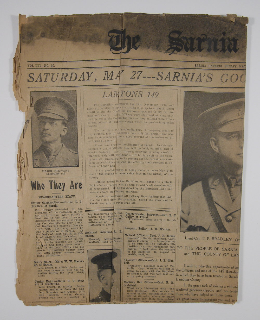 This 1916 newspaper was been creased and soiled when it came in to the studio.