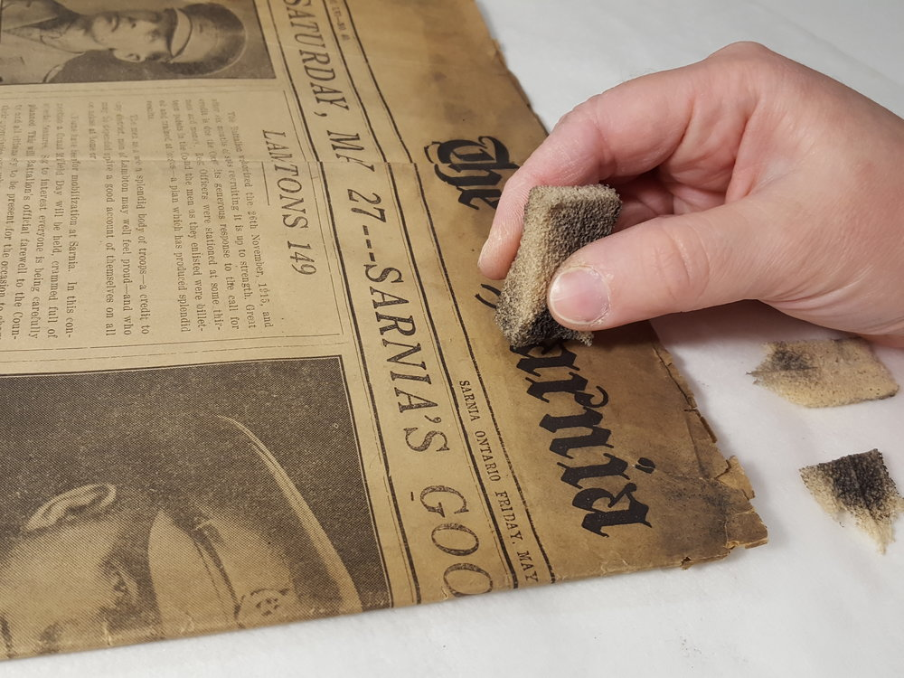 Surface cleaning a newspaper.