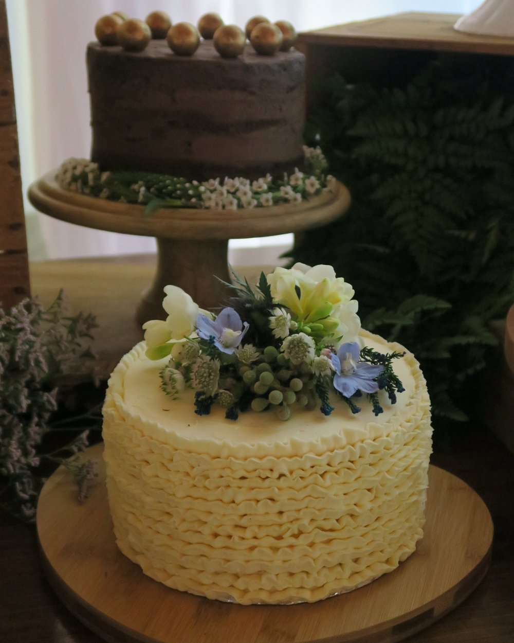 Buttercream ruffles with fresh flowers.jpg