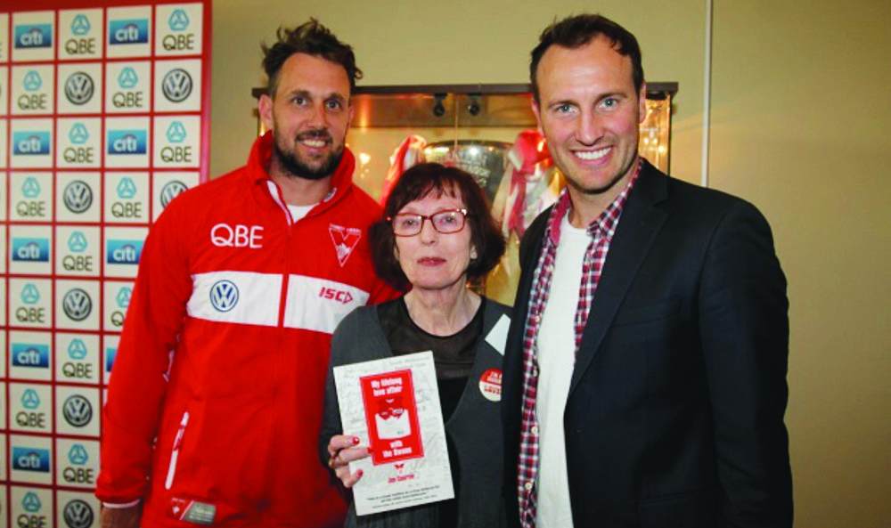 Author Jan Courtin poses with 2005 premiership stars Nick Davis and Jude Bolton. (Photo posted on the Swans webpage after the launch)