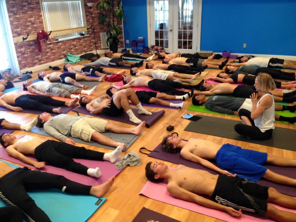 yoga with soccer team.jpg