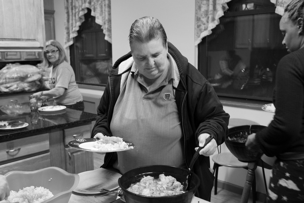 Communal dinner in Carol's transitional housing. Long Island City, NY (2015)
