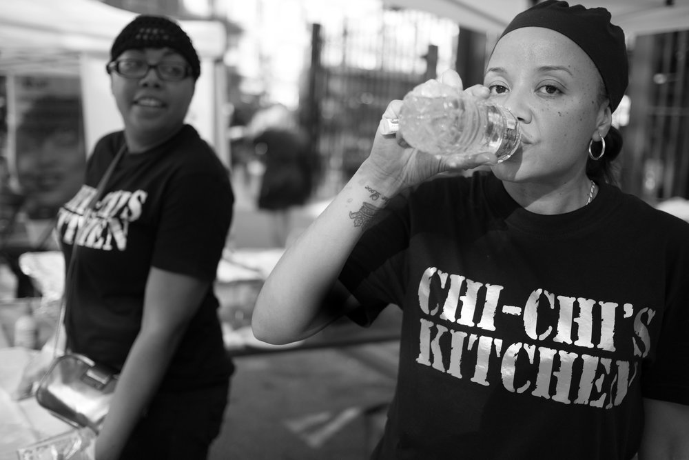 Keila, with her own catering business, Chi Chi's Kitchen, at a street fair. New York, NY (2017)