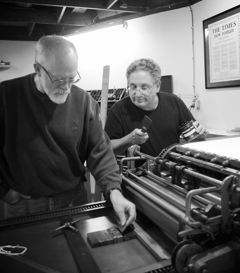 Robert and Alan working on their press
