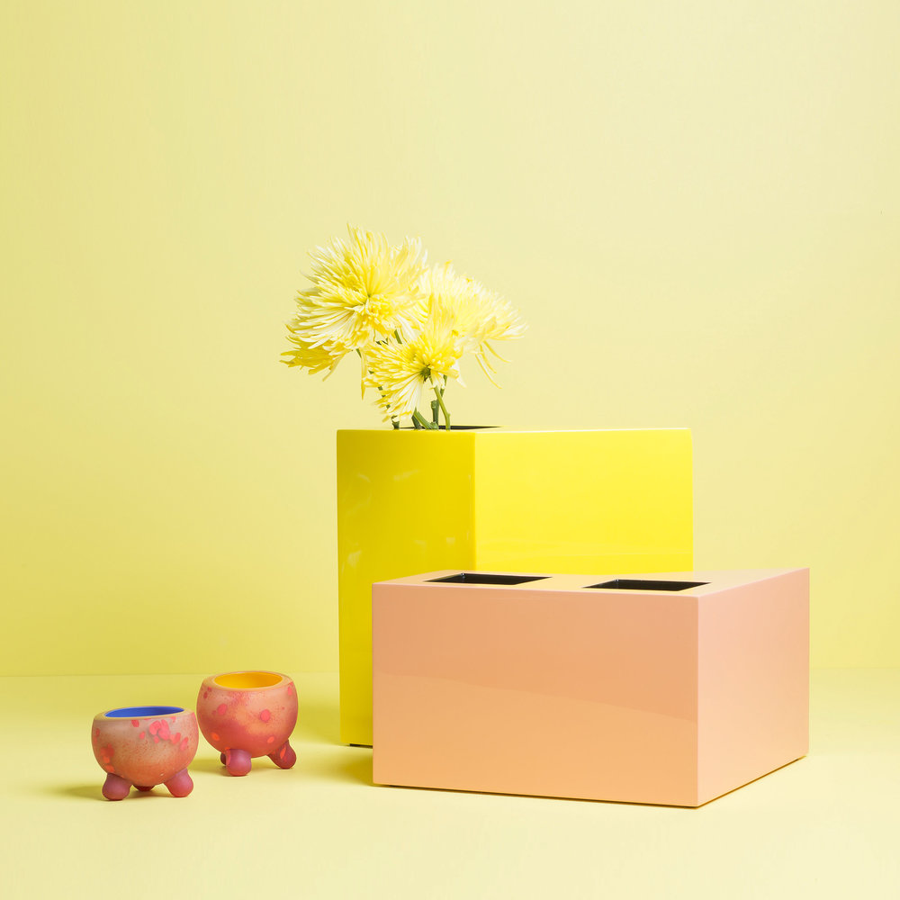 """LACQUER VASE SET 1  Buff: 12"""" x 12"""" x 7"""" H  Yellow: 6"""" x 12"""" x 12"""" H  Buff & yellow lacquer    Glass piece byAlison Siegel andPamela Sabroso"""