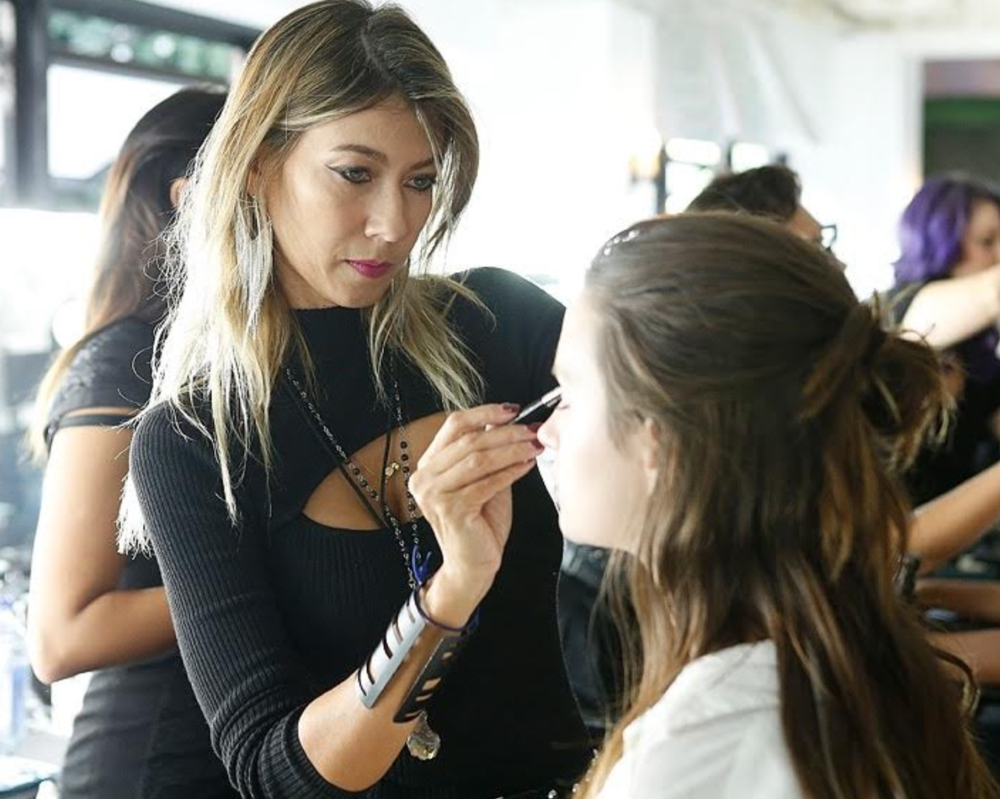 Behind the scenes at NY Fashion Week, where Marcia is doing make up.