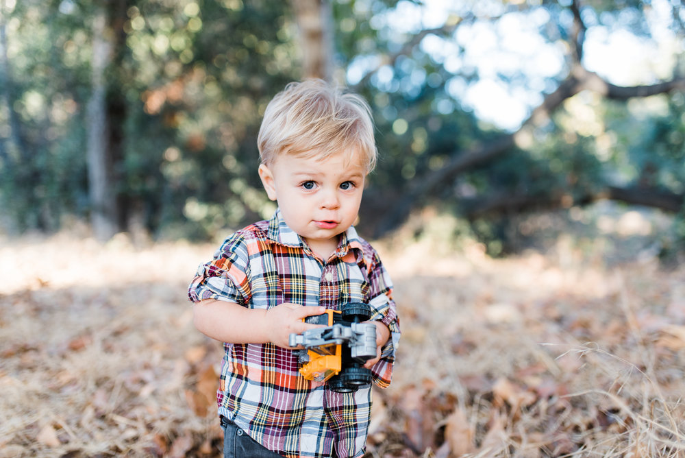 Aiden's favorite toy happens to be a trucks! Even during this photo shoot, he couldn't be without it!   Photo credit  Chelsea Frandsen Photography