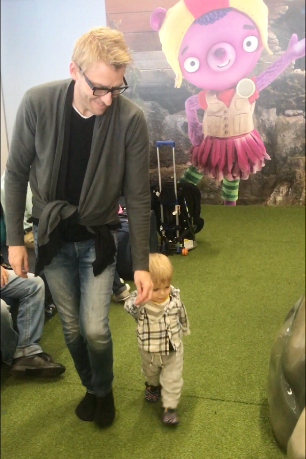 My husband spending time with Aiden in the Amazon / Jet Blue play zone at JFK airport.