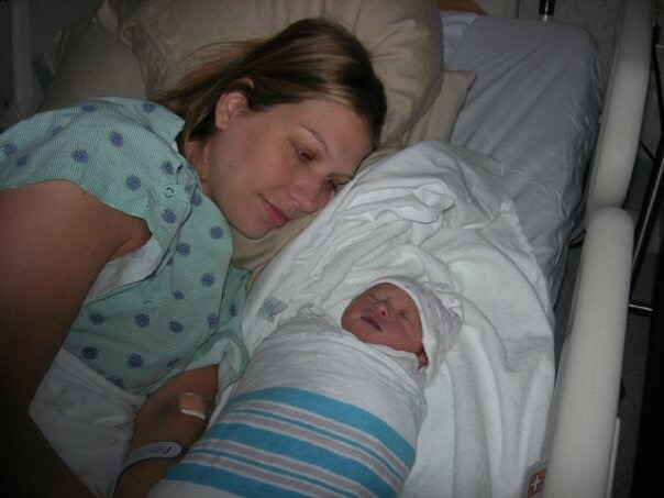 Kristen is pictured here cherishing every moment after the birth of her miracle baby girl.