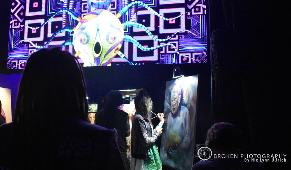 Venue Goers admiring the live artists paint.