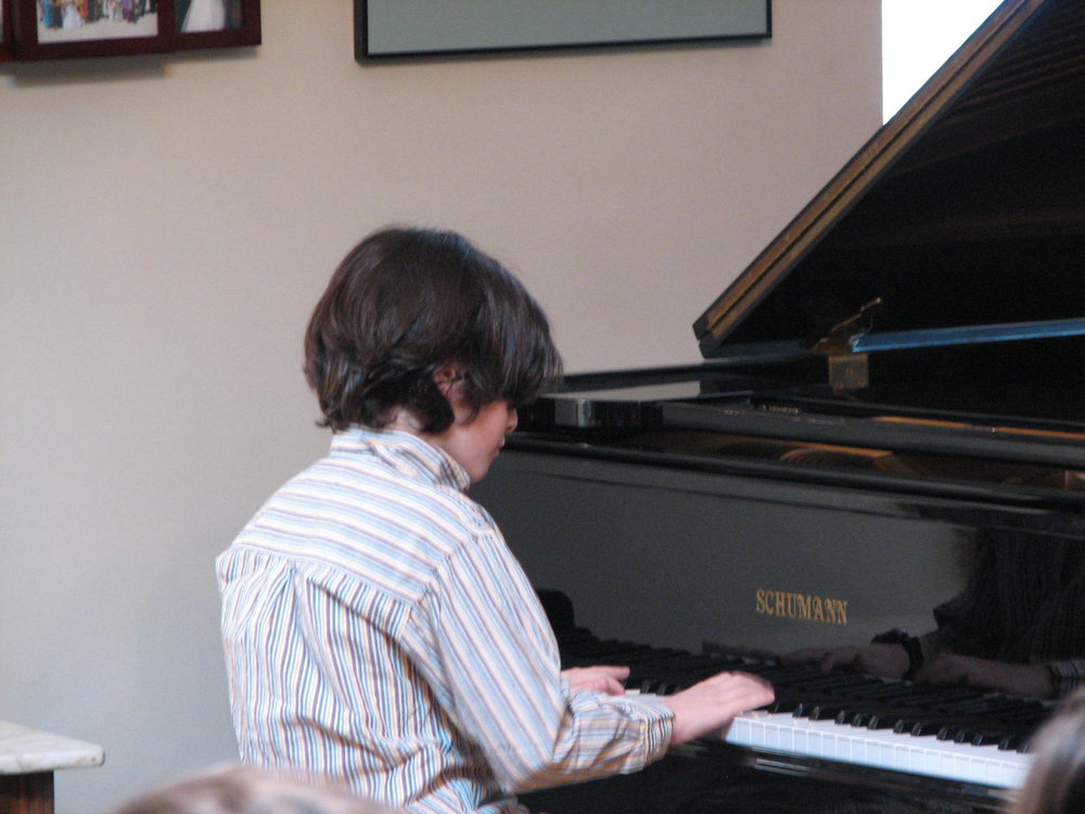 Student performing at informal piano event