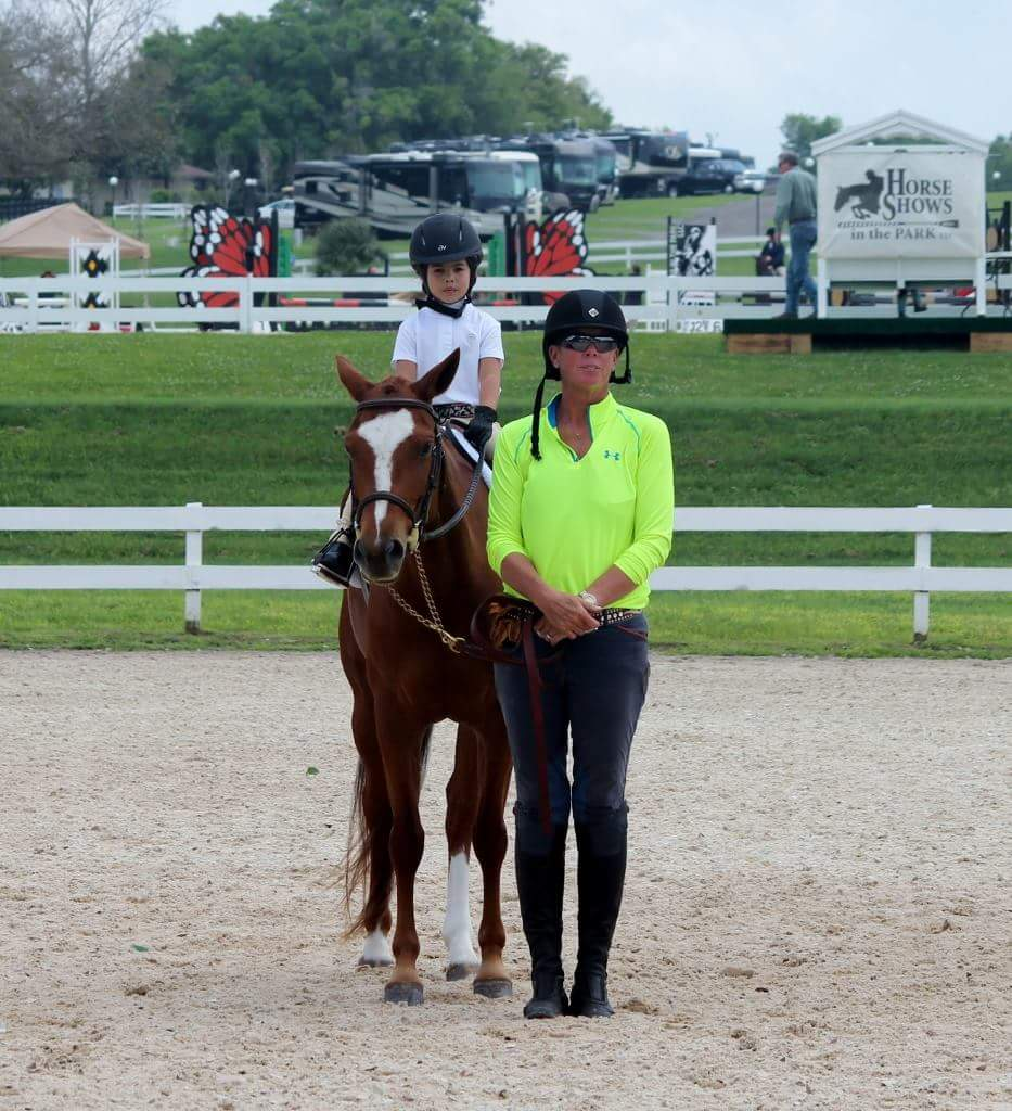 Liz - Extremely hard working trainer who lends her encouragement and patience to every student and horse in her care.