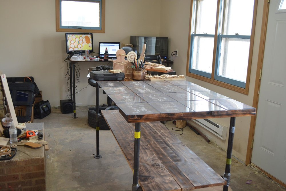 This is the first shop I ever called my own.  I started with an empty room and, over time, added a collection on computer numerically controlled equipment and custom shop tables.  I still use these tables and tools to this day, although in another shop.