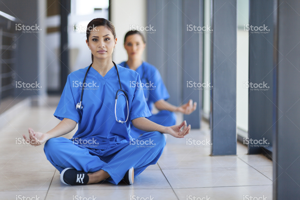 stock-photo-22056939-young-healthcare-workers-meditation-during-break.jpg