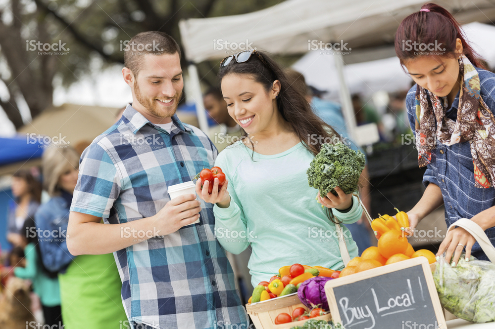 stock-photo-37495164-happy-couple-shopping-at-a-busy-local-farmers-market.jpg