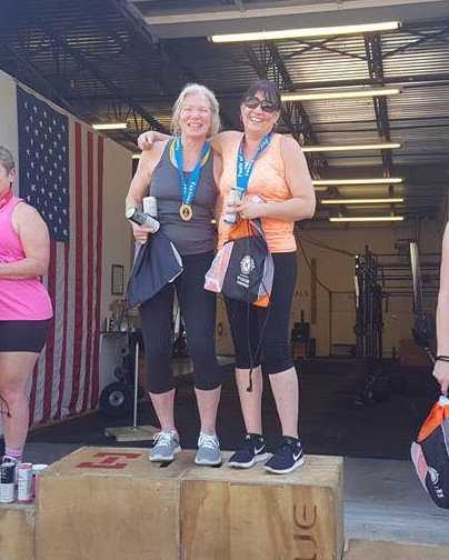 Laura and Lucia coming in first place at Festivus Fall 2017 CrossFit competition! Team name-The Unit