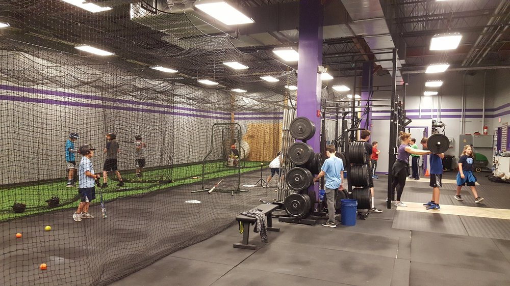 CrossFit Homeward boasts retractable baseball nets which allow for strength training and baseball specific training to occur simultaneously!
