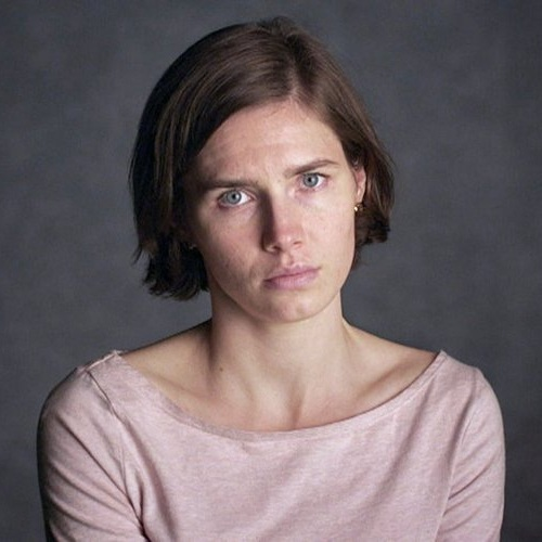 """Her expression is serious, almost gaunt, and her hair is much darker and cropped. Her posture is uncomfortable displayed against the austere background where she has been placed. At times, Knox is wary of the camera, regarding it tentatively or struggling for words. At other times, she is deliberate, almost exasperated, as she articulates her story."" — Katie Elder"
