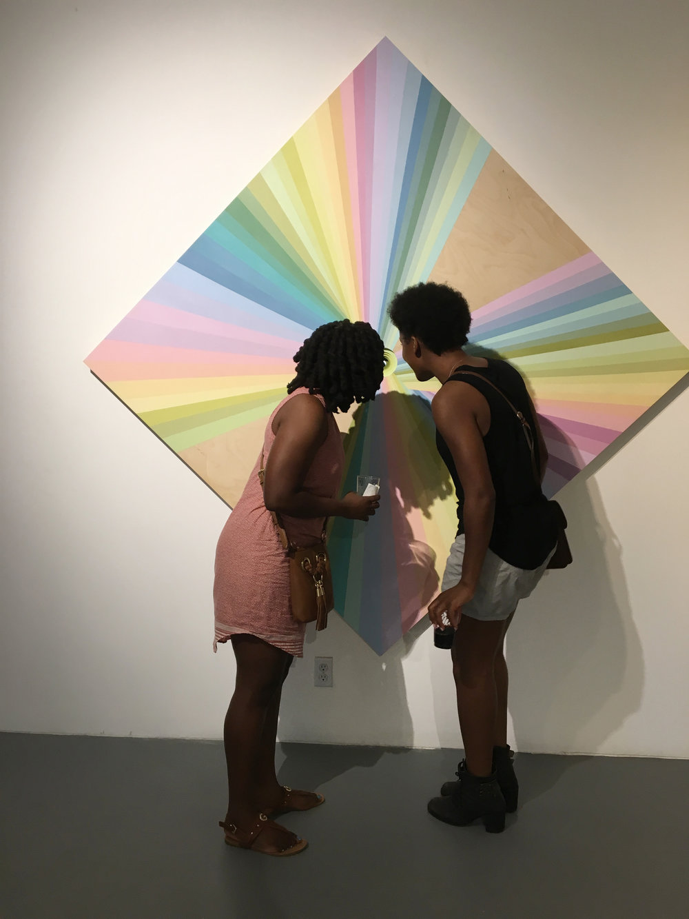 viewers with Rainbow warriors painting.jpg