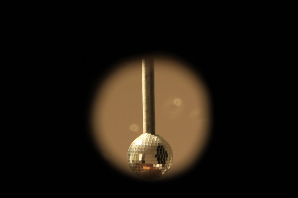 """View through G.L.O.W. (Gone Living Out West) painting to the """"Domestic Disco Ball"""""""