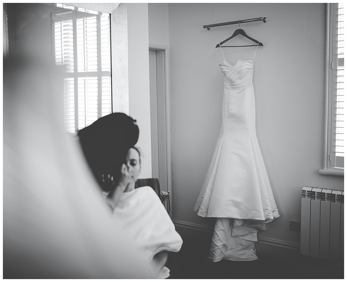 brides dress as they get ready