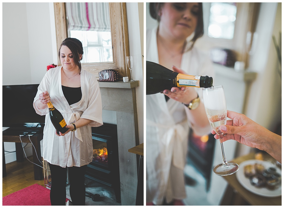 pouring the drinks - getting ready pictures at samlesbury hall wedding