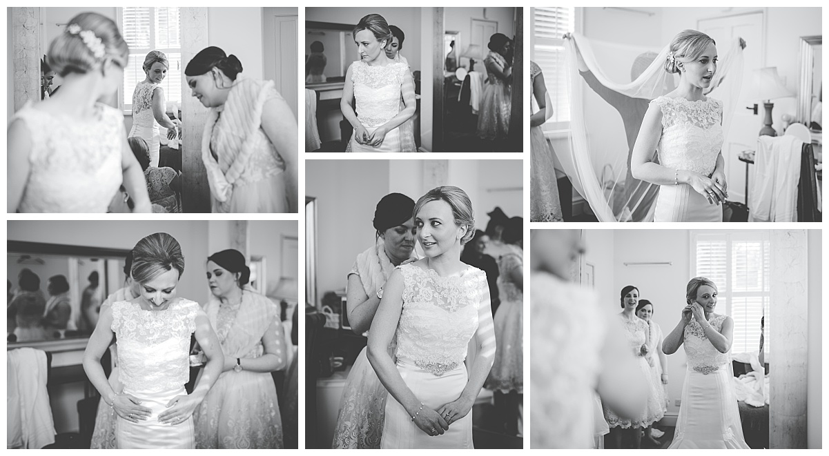 getting into the dress - black and white images from samlesbury hall wedding in preston lancashire