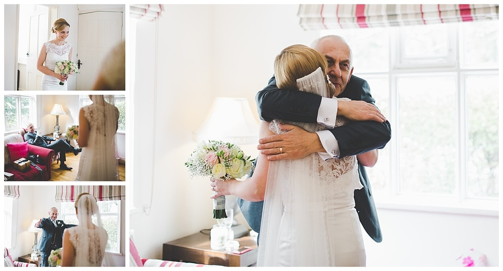 dad sees bride for first time -samlesbury hall wedding - documentary wedding photographer