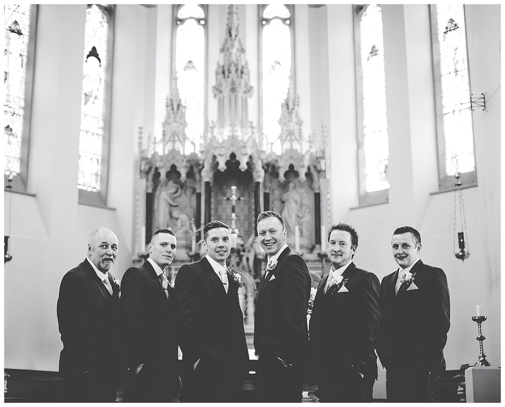 stunning shot of groom and groomsmen in church