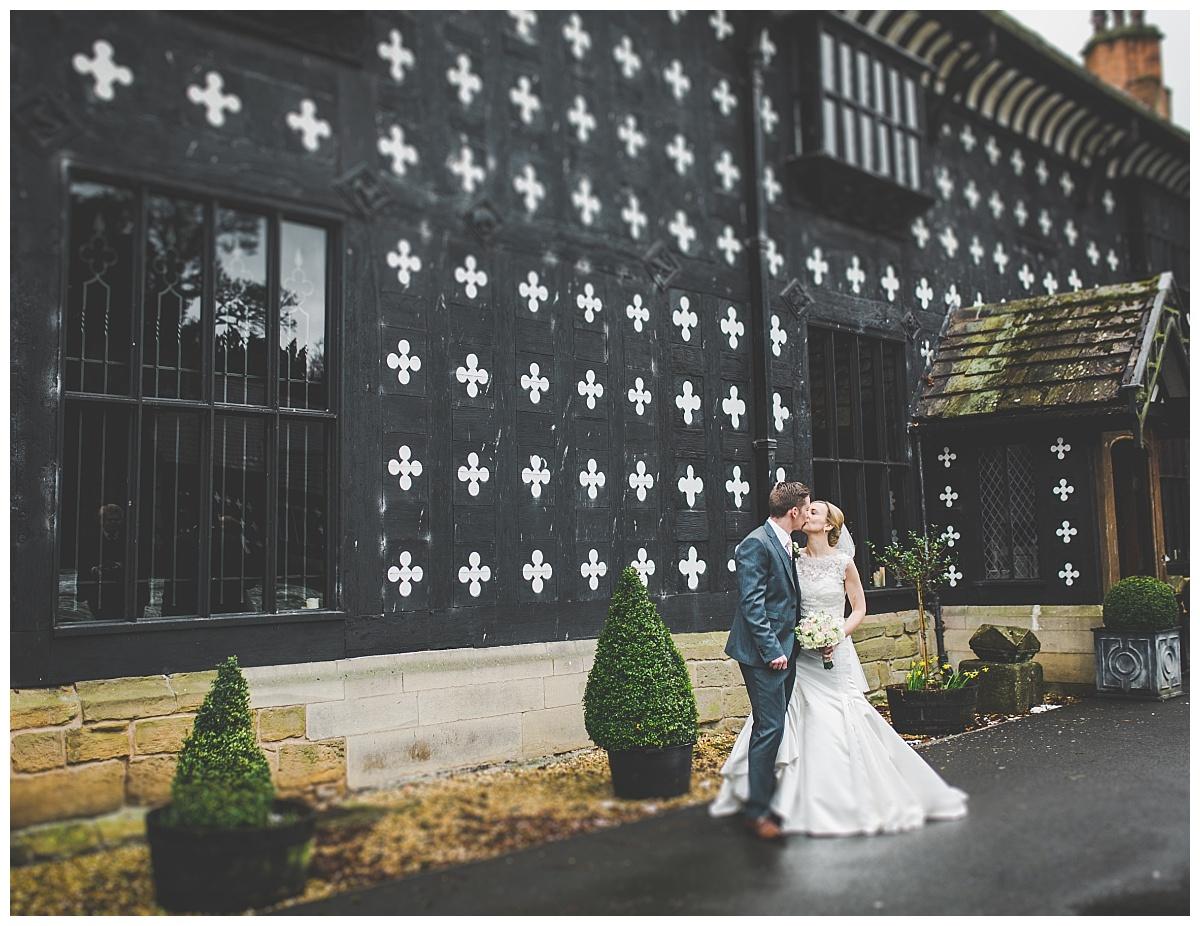 bride and groom photographs outside samlesbury hall