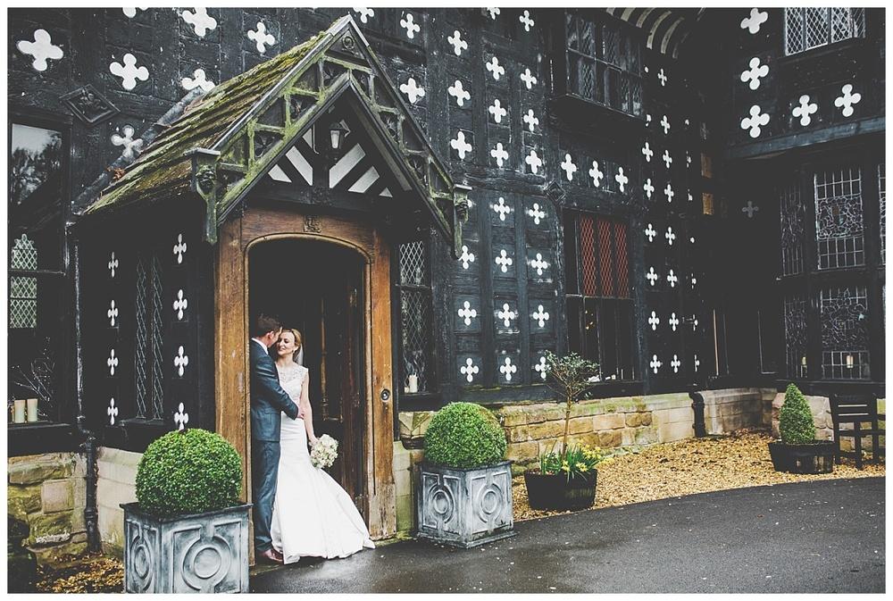 bride and groom in doorway at samlesbury hall