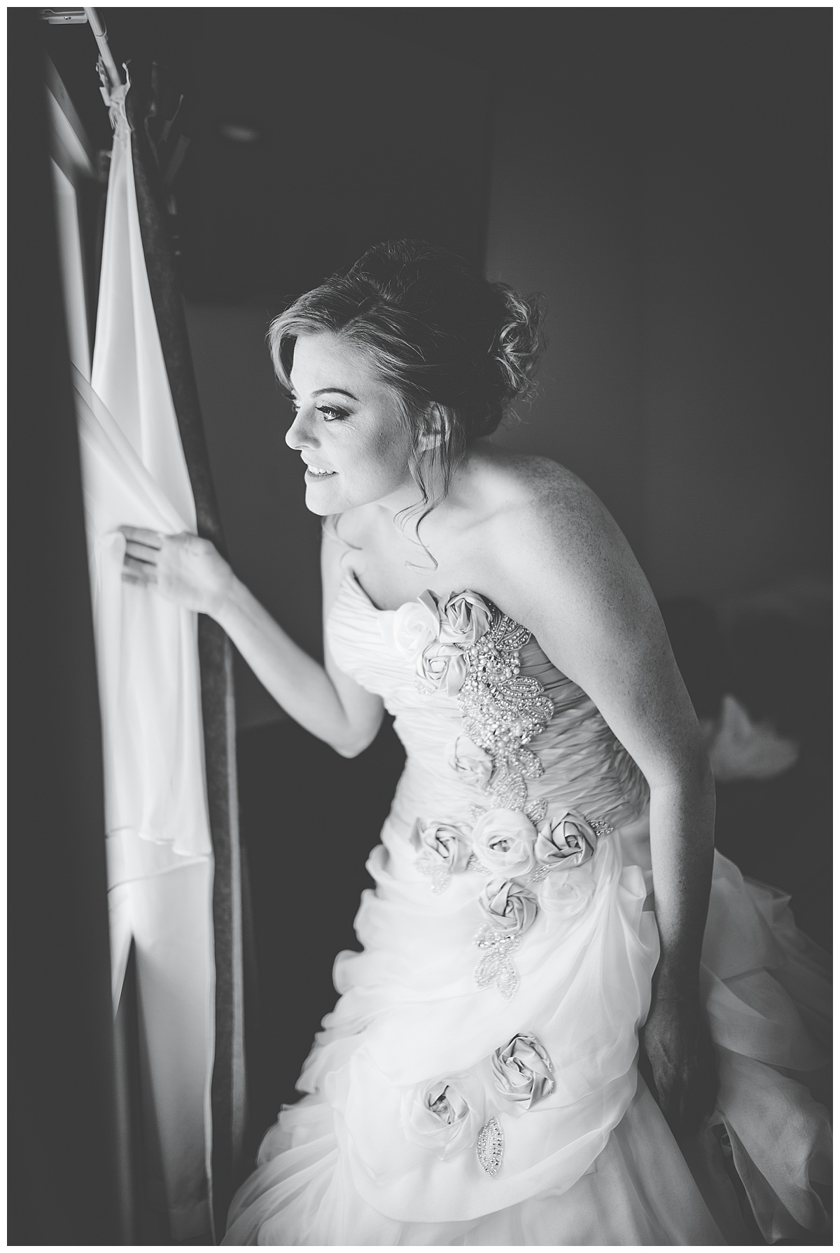 bride looking out of the window at mytton fold wedding venue