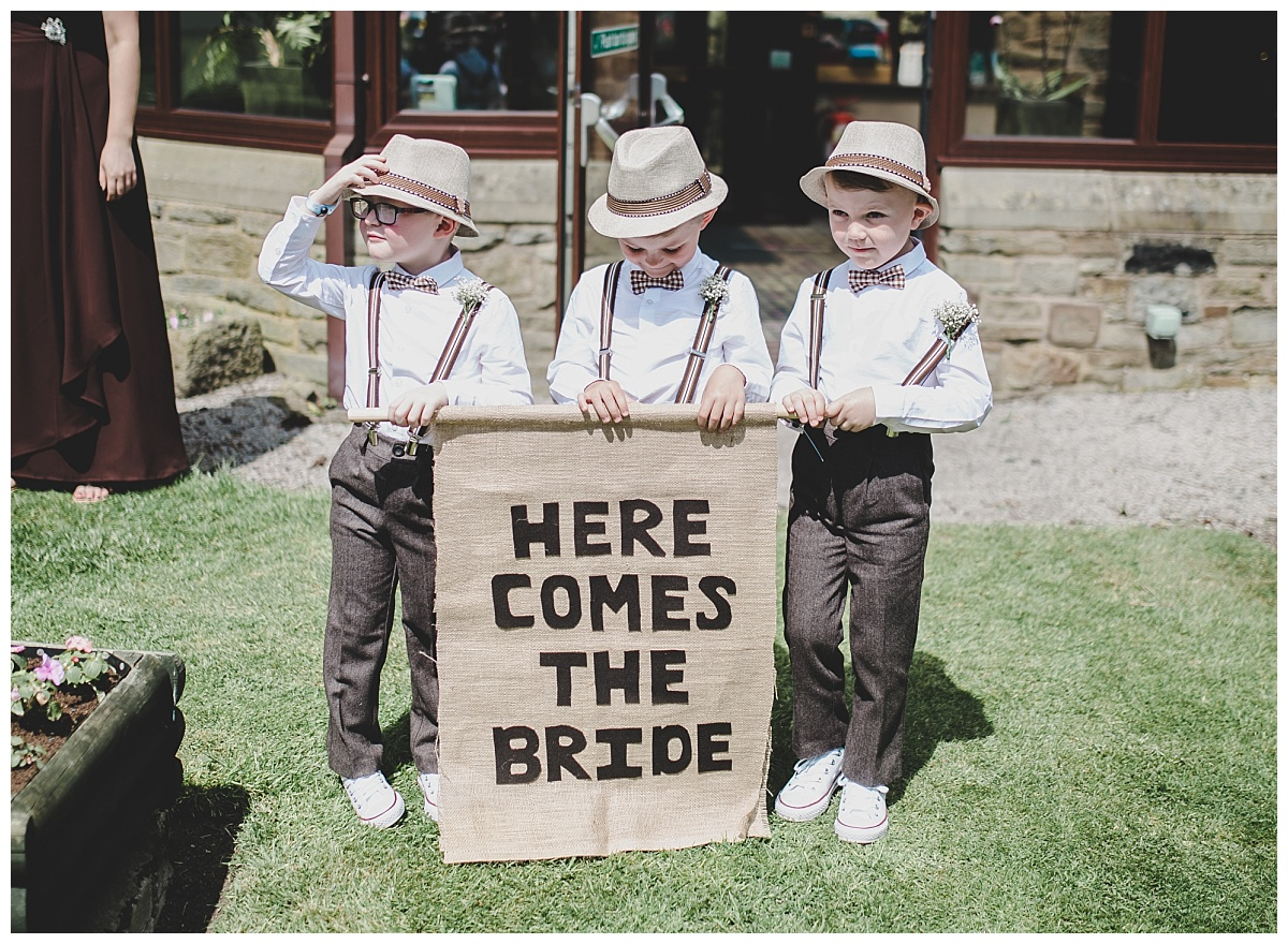 page boys holding a sign