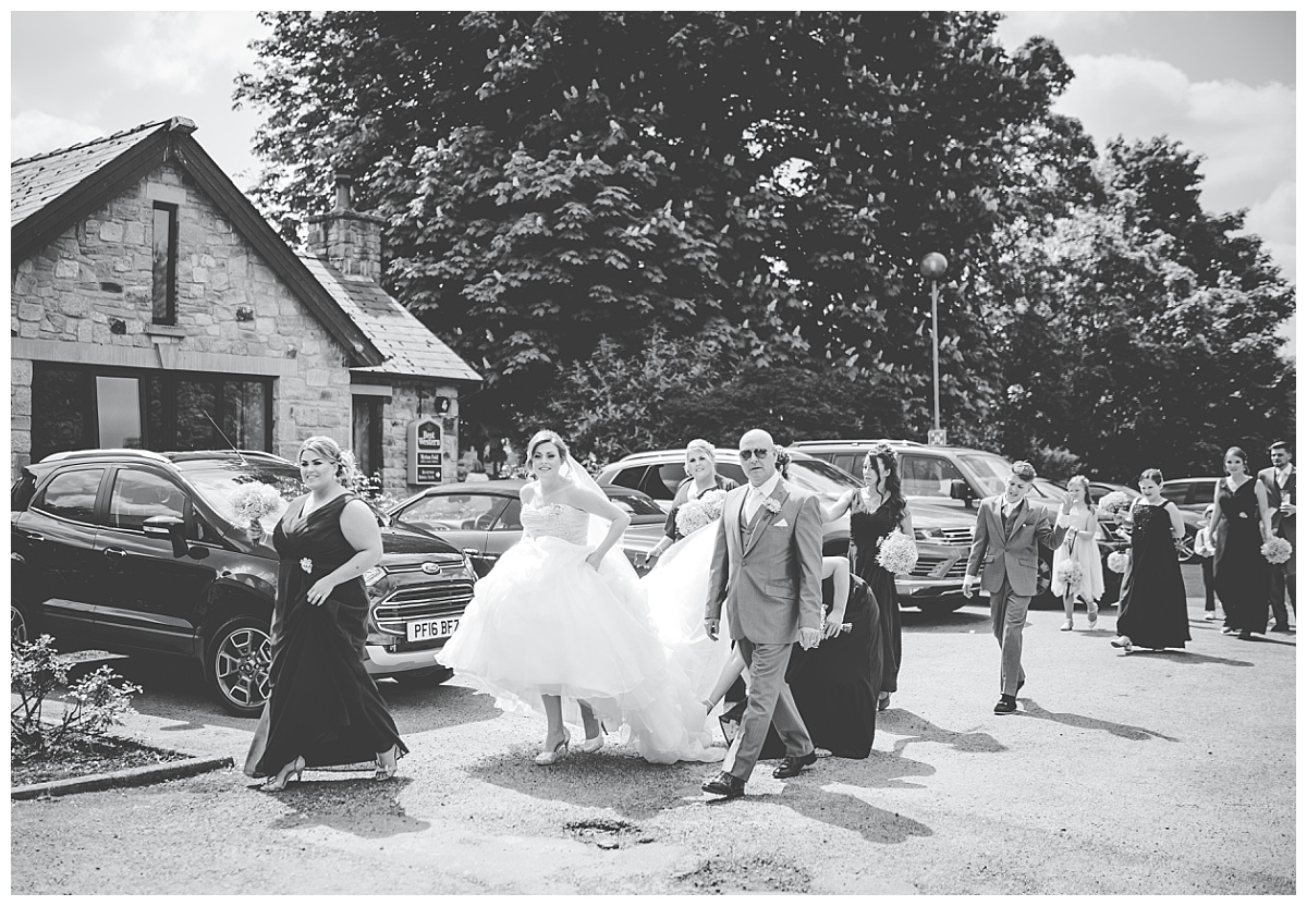 bride walking to ceremony at mytton fold