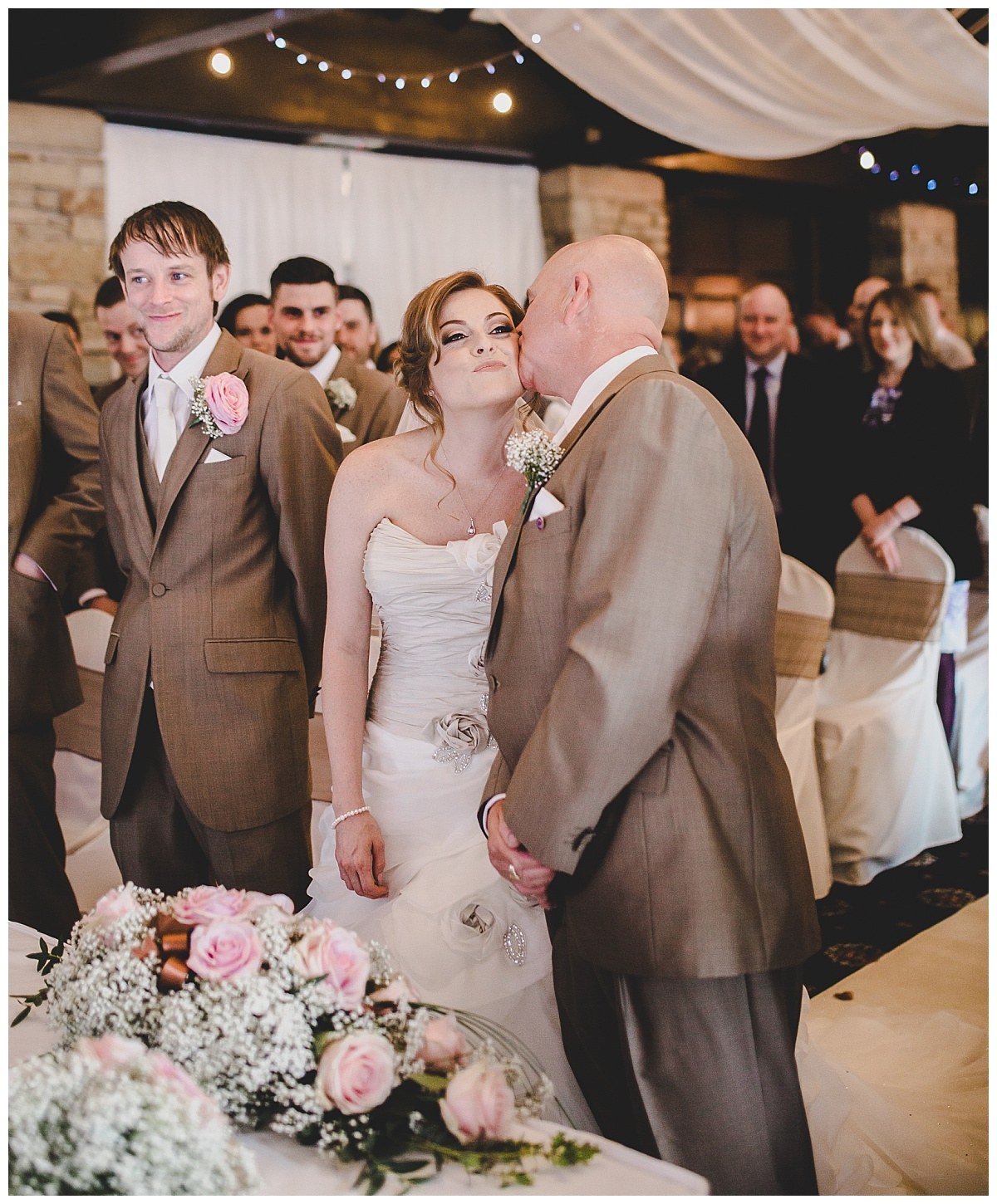 documentary photographer in lancashire capturing all the natural moments - bride gives dad a kiss