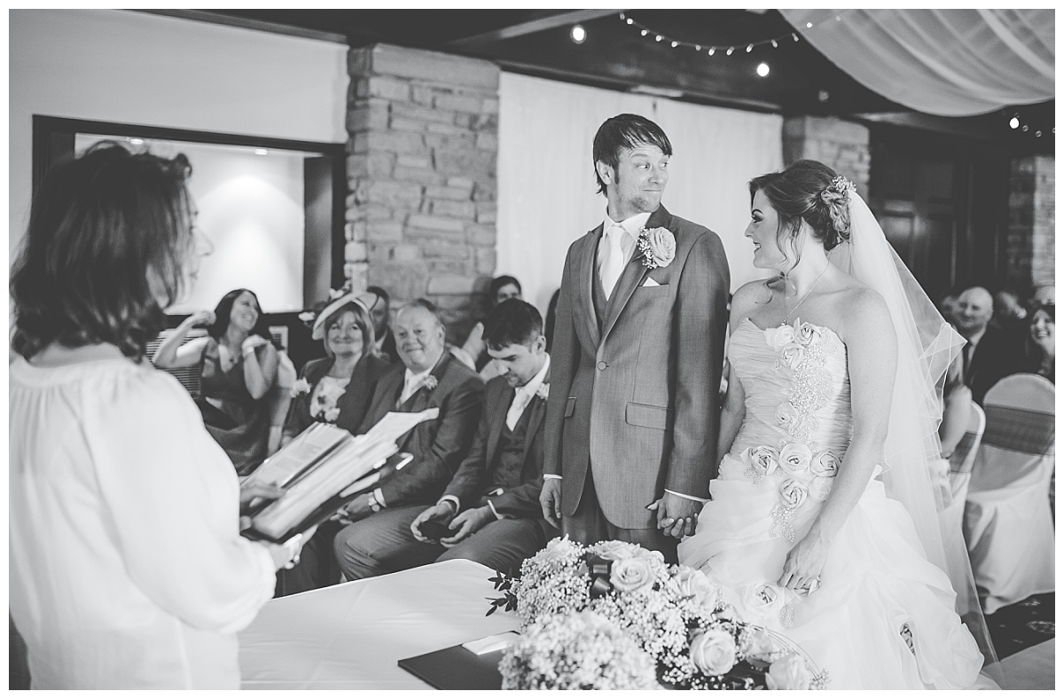bride and groom look at each other during the ceremony
