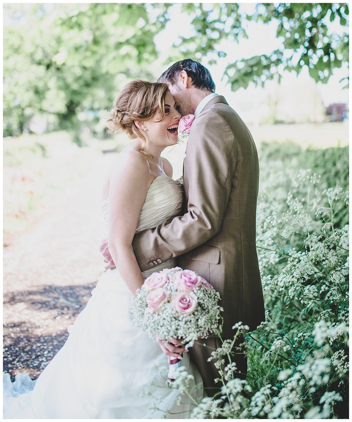groom whispers to the bride - mytton fold wedding