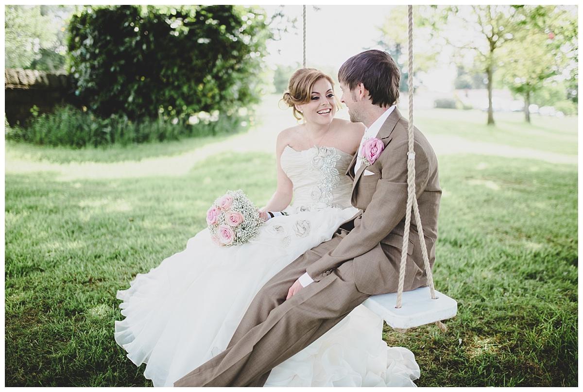 bride and groom on the swing - lancashire wedding