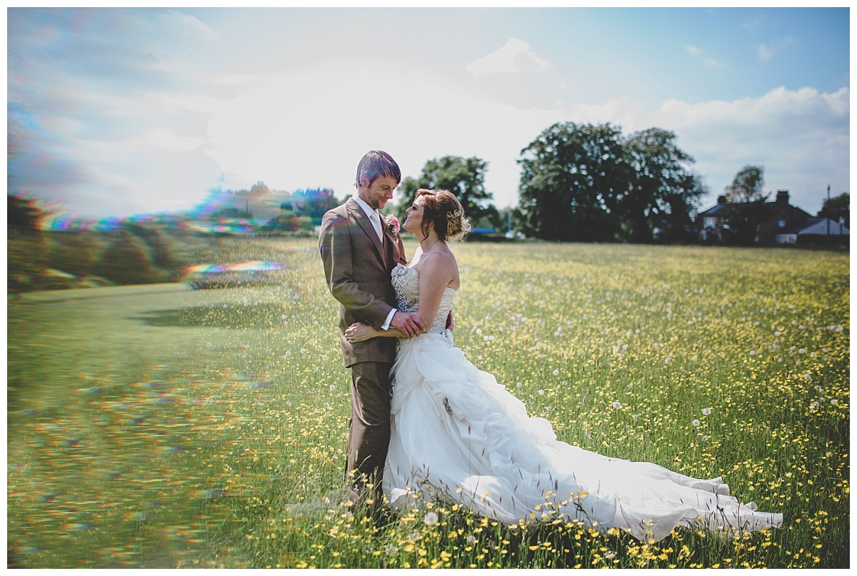 bride and groom in the meadow at mytton fold
