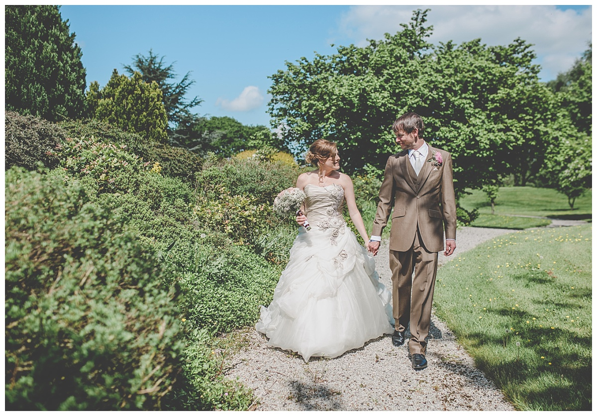 couple walk through the gardens at mytton fold - natural relaxed photographer