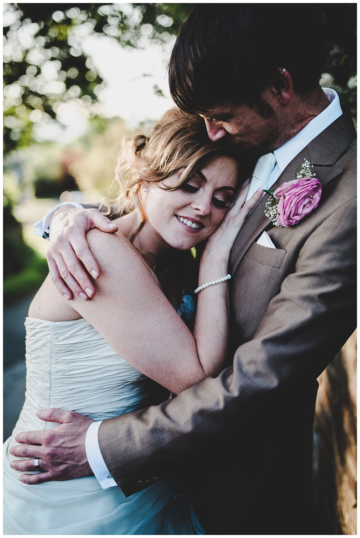 natural wedding photography in lancashire - bride cuddles groom
