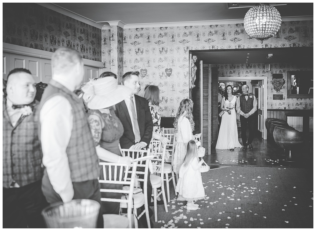 bride coming down the aisle at Shireburn Arms