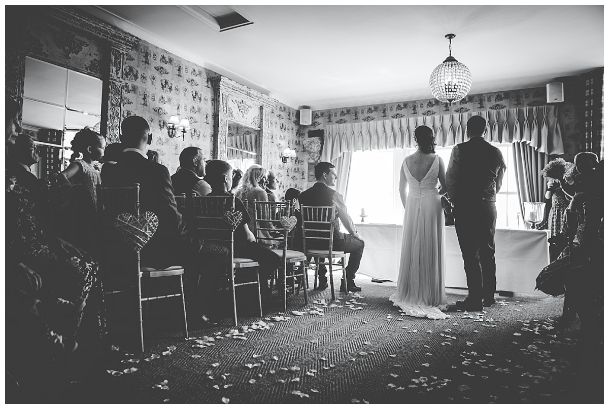 bride and groom during the ceremony at Shireburn Arms in Clitheroe