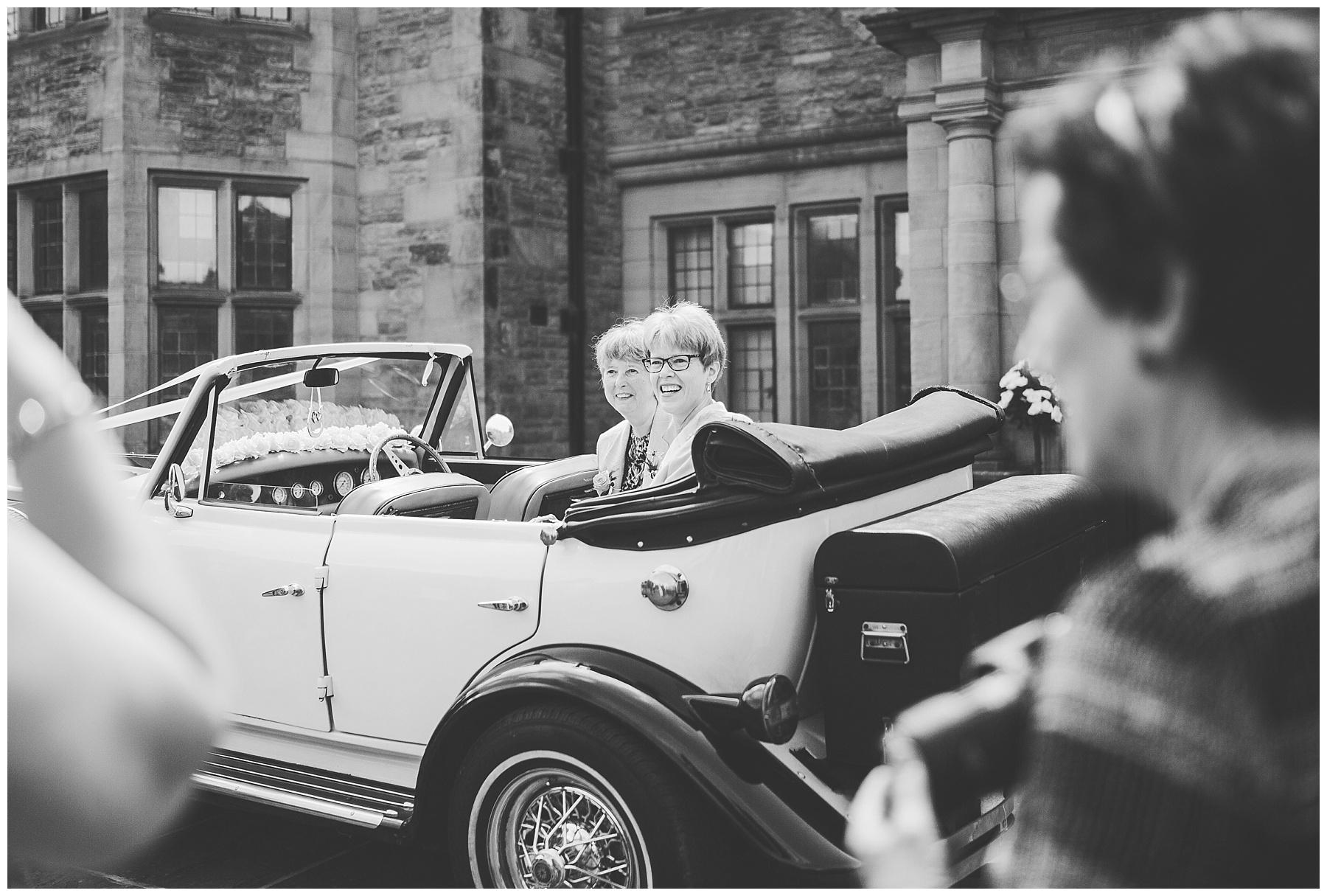 Beams of joy from the wedding car- outside haworth art gallery